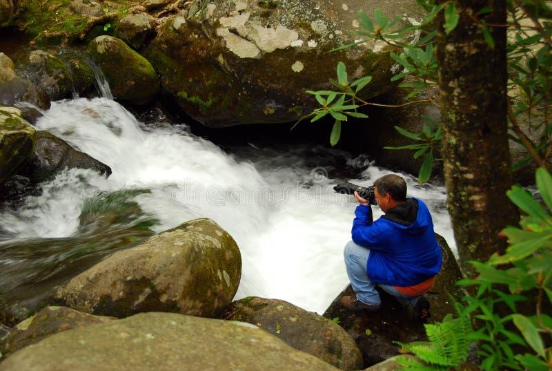 De fotograaf van het avontuur stock afbeelding