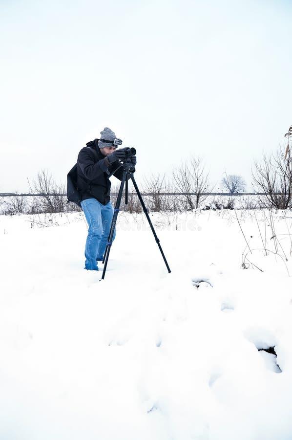 De fotograaf van het de winterlandschap royalty-vrije stock fotografie