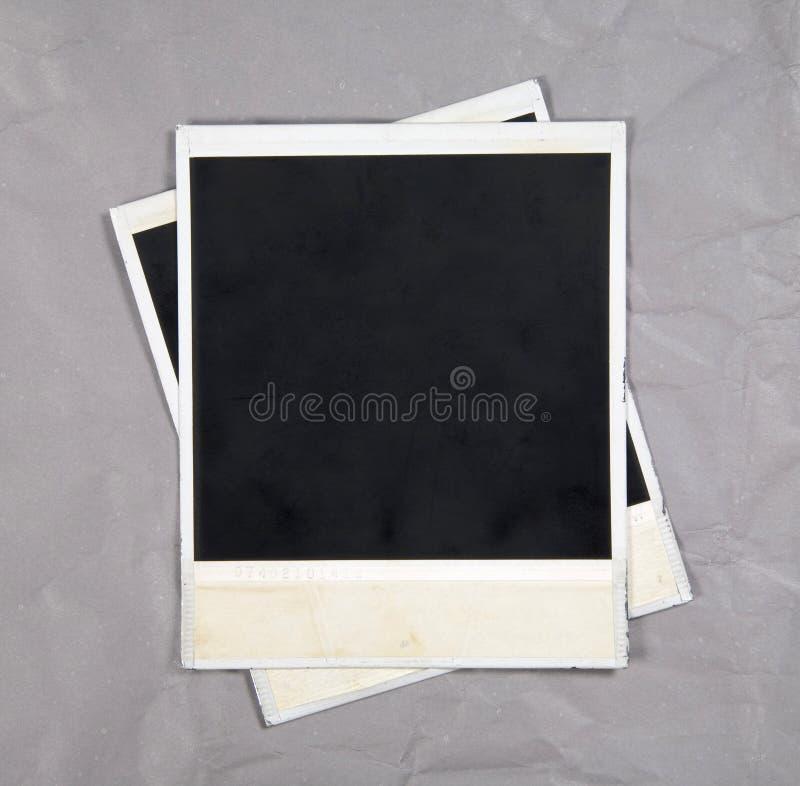 De Frames van de foto op de Achtergrond van het Document stock fotografie