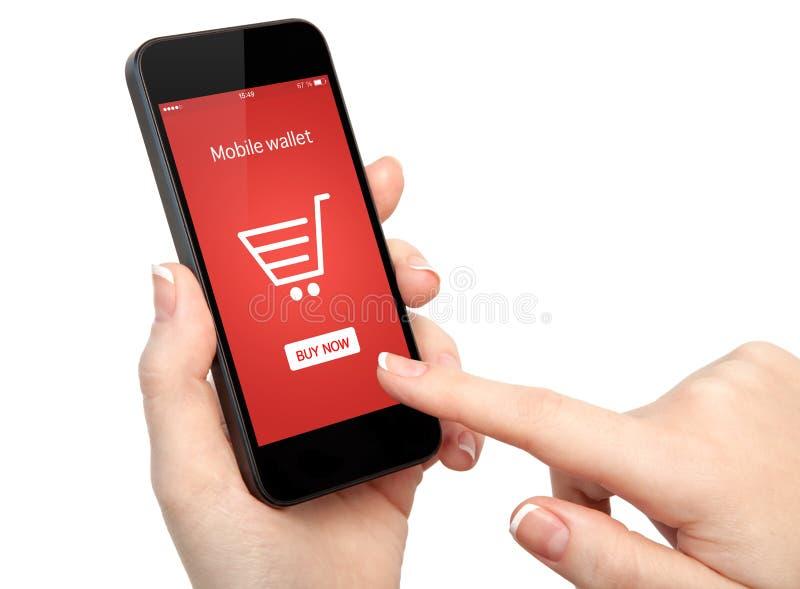 De geïsoleerde vrouwenhanden die een telefoon houden en maken online het winkelen stock afbeeldingen
