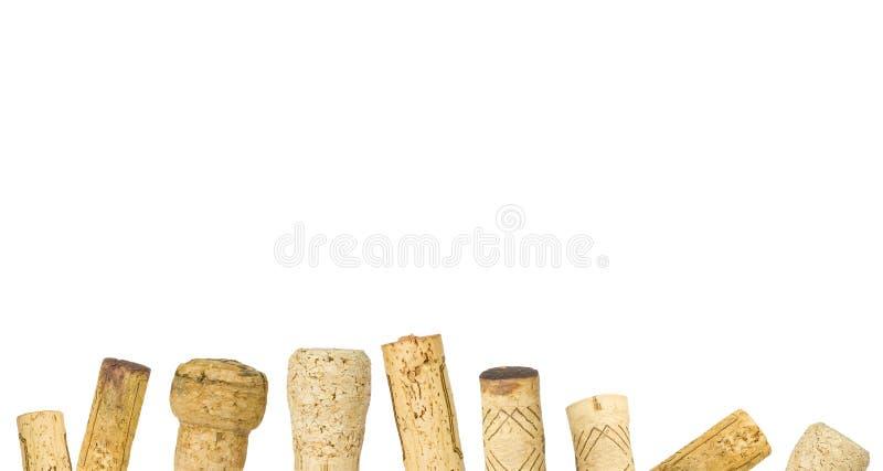 De geïsoleerde wijn kurkt rijontwerpsjabloon, witte achtergrond royalty-vrije stock foto