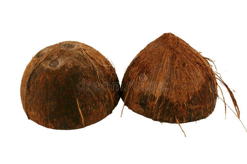 De geïsoleerdee kokosnotenhelften op witte achtergrond stock foto