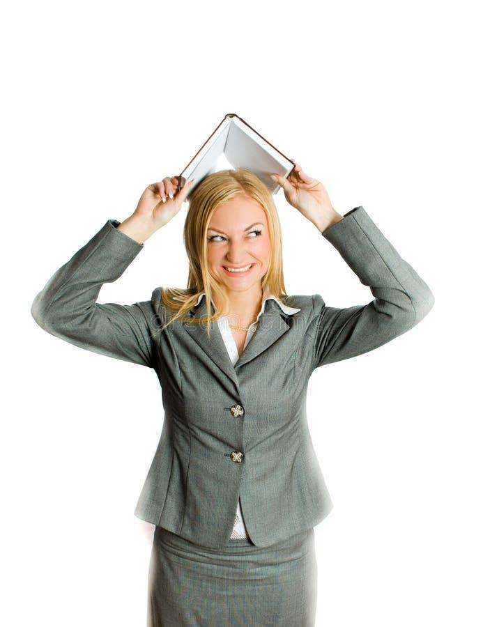 De geïsoleerdeg onderneemster van de blonde in het kader van boek royalty-vrije stock foto