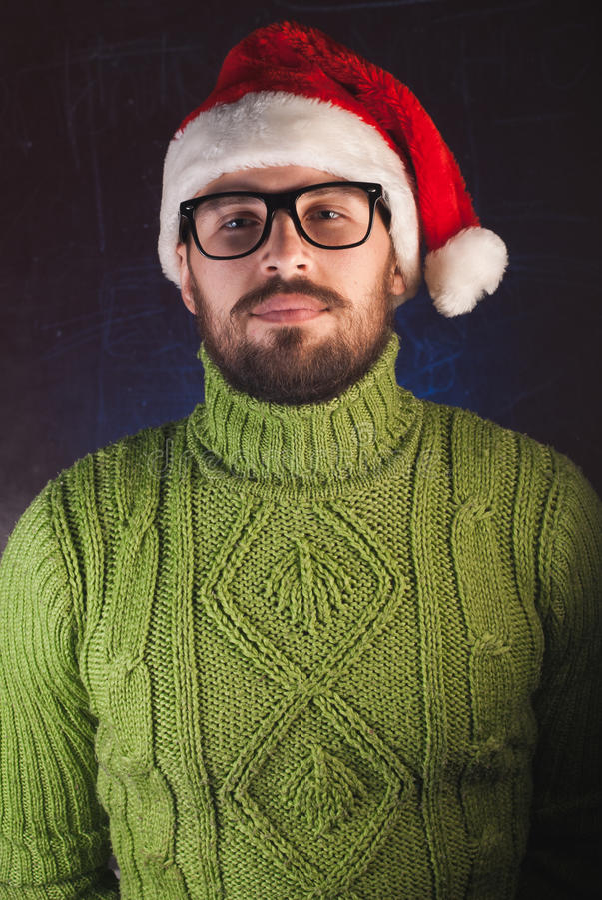 De gebaarde man in rode Kerstmishoed Santa Claus, royalty-vrije stock foto