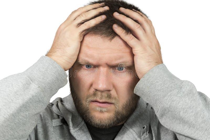 De gebaarde mens greep zijn hoofd stock fotografie