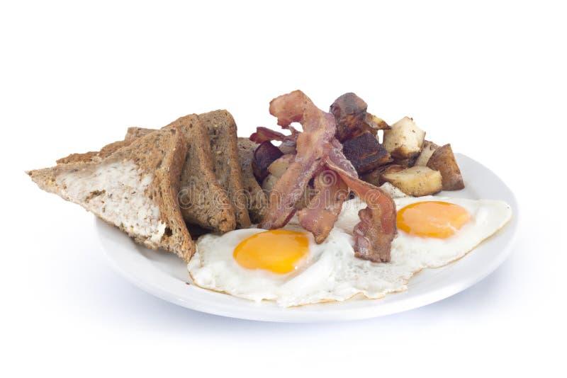 de gebakken aardappelen en de toost van baconeieren royalty-vrije stock afbeelding