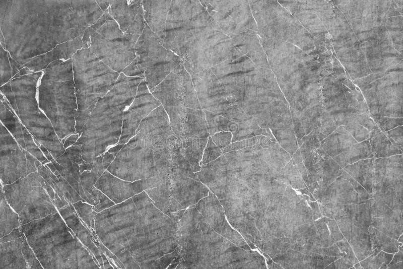 De gebarsten concrete achtergrond van de steenmuur Gekraste abstracte grijze muur stock foto