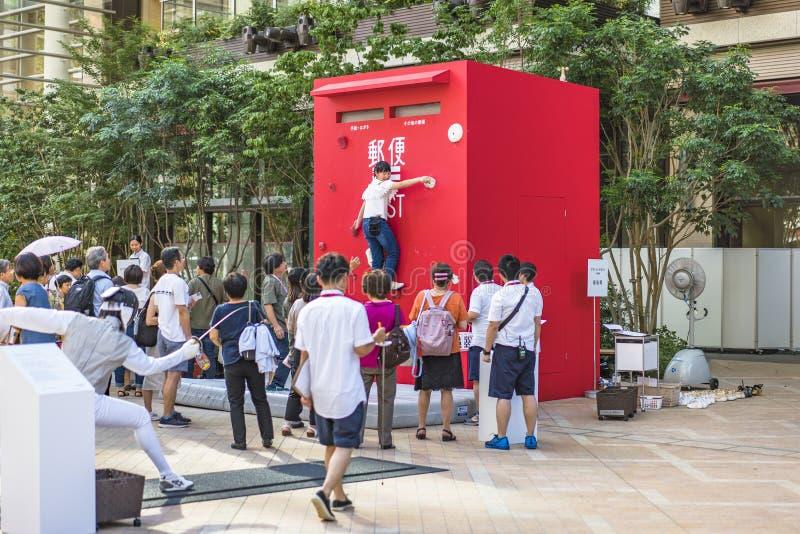 De gebeurtenis 'is de verandering Tokyo 2020 'georganiseerd op het thema van de toekomstige Olympische Spelen in Tokyo in 2020 stock fotografie