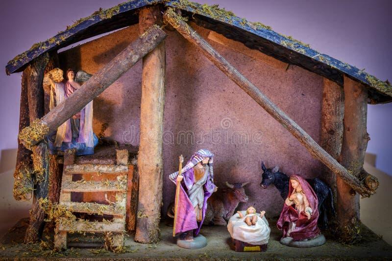 De Geboorte van Christusscène van het Kerstmisornament van Bethlehem Mary, de koe van Joseph en Jesus The Angel The-en de os stock afbeeldingen