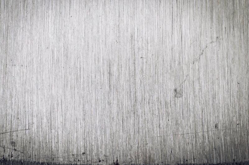 De geborstelde gekraste textuur van de roestvrij staalclose-up stock afbeelding