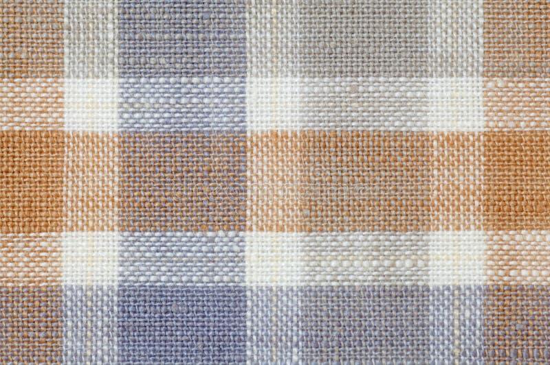 De gecontroleerde textuur van het stoffenpatroon stock fotografie