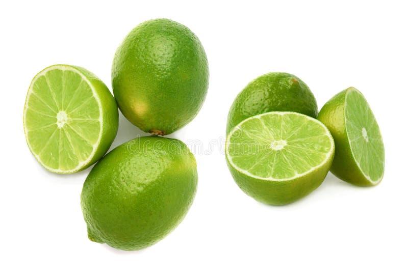 De gediende die samenstelling van het kalkfruit over de witte achtergrond, reeks wordt geïsoleerd verschillende foreshortenings stock fotografie