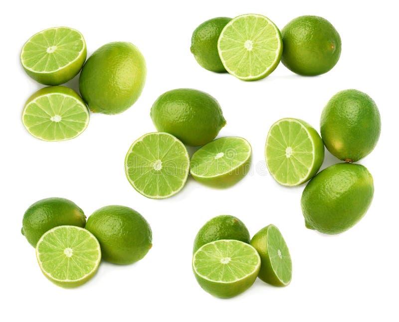 De gediende die samenstelling van het kalkfruit over de witte achtergrond, reeks wordt geïsoleerd verschillende foreshortenings stock foto