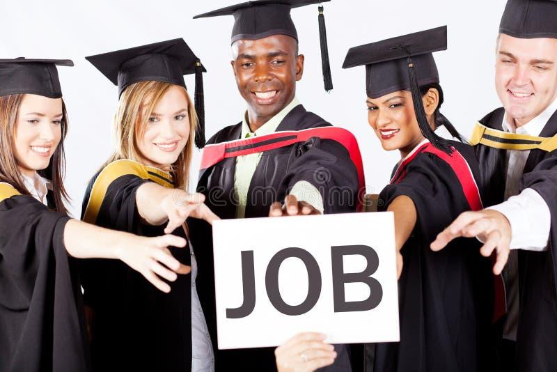 De gediplomeerden grijpen baan stock fotografie