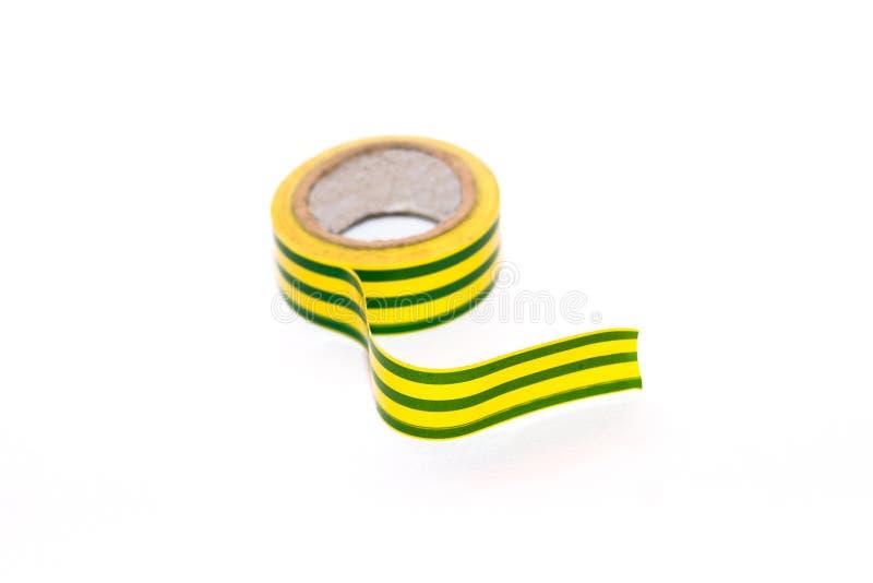 De geelgroene het isoleren goede bescherming van de bandwaarborg tegen voltage en kort:sluiten met elektrische stroom stock afbeelding