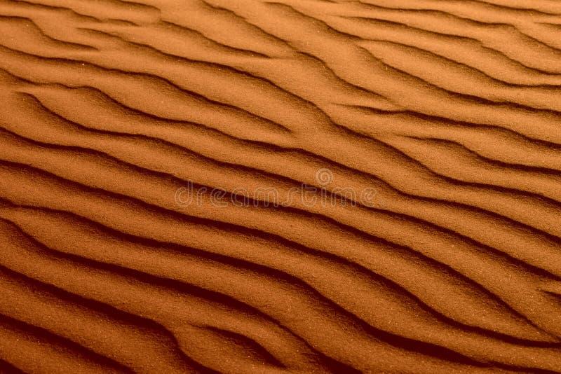 De gegolfte Roodbruine Textuur van het Zand van het Strand royalty-vrije stock foto