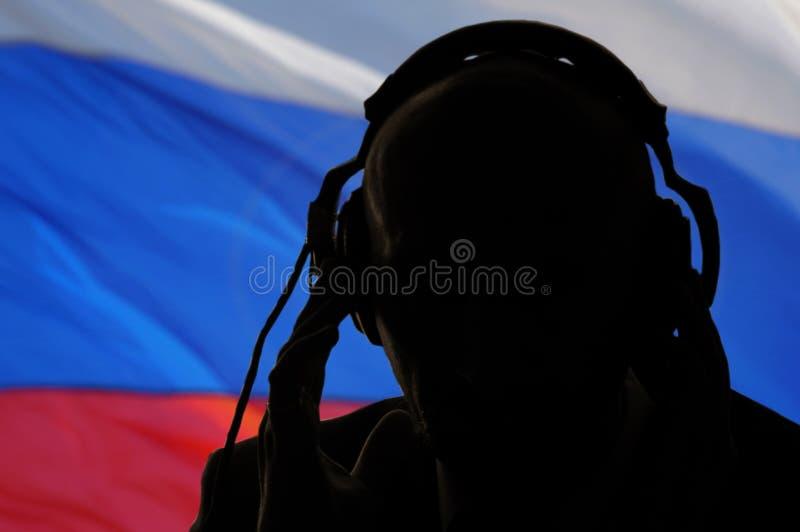De geheimagent luistert gesprek, Russische spion af stock afbeeldingen