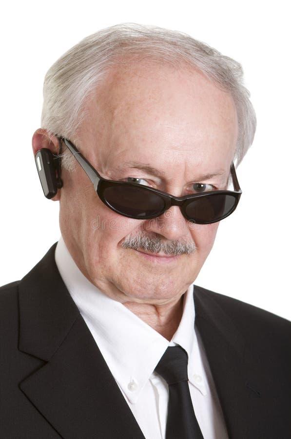 De geheimagent van Senoir met hoofdtelefoon royalty-vrije stock foto's