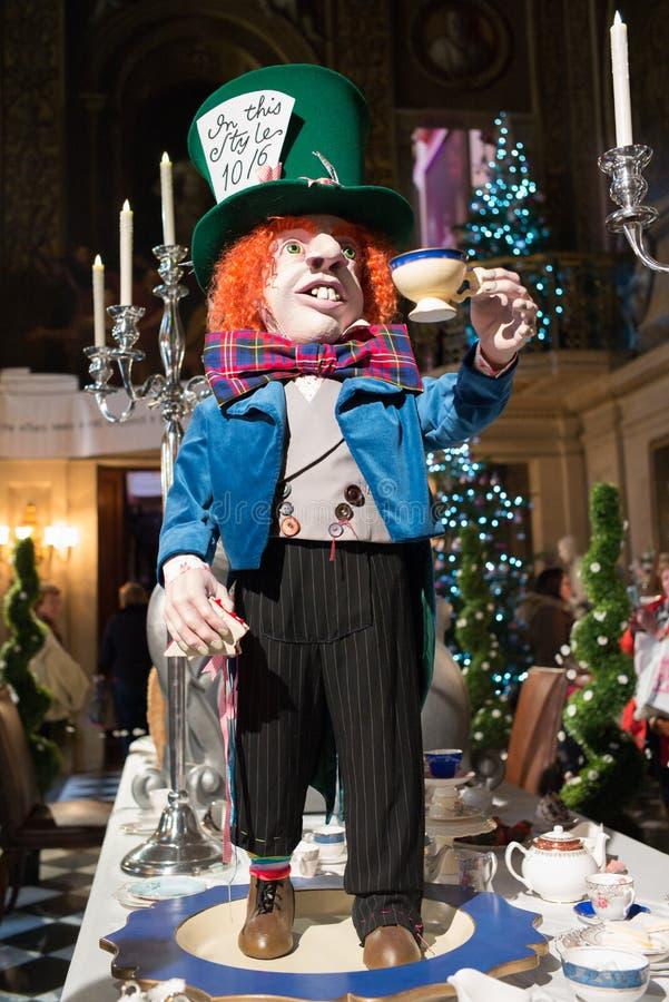 De gekke hoedenmaker Alice in sprookjesland stock afbeeldingen
