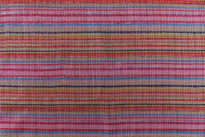 De gekleurde achtergrond van de streepstof Kleurrijke Doek De textuur van de manier stock foto's