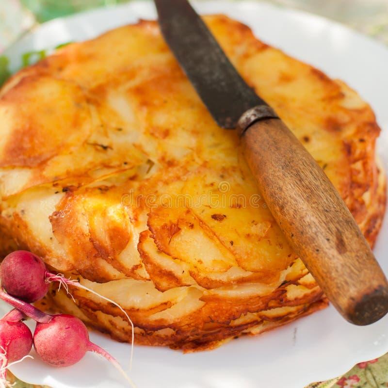 De gelaagde Aardappel bakt stock afbeeldingen