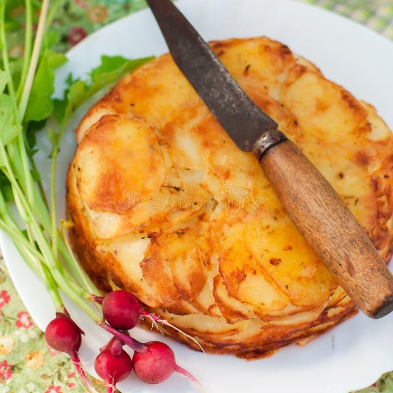 De gelaagde Aardappel bakt stock afbeelding