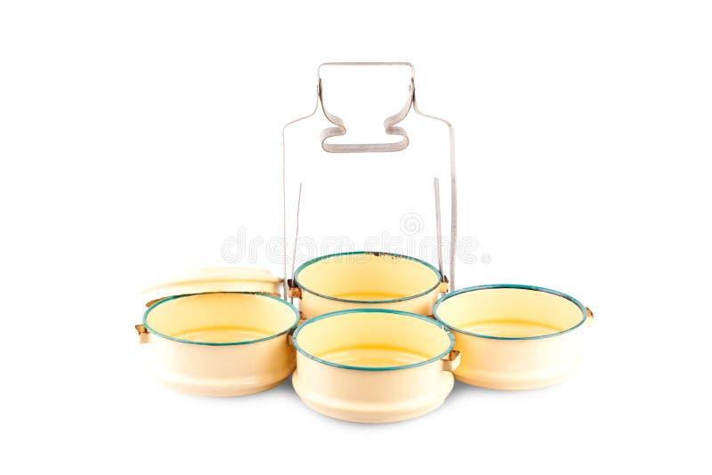 De gele drager van het metaalvoedsel of de uitstekende drager van het tiffin Thaise voedsel op wit achtergrond geïsoleerd keukeng royalty-vrije stock afbeelding