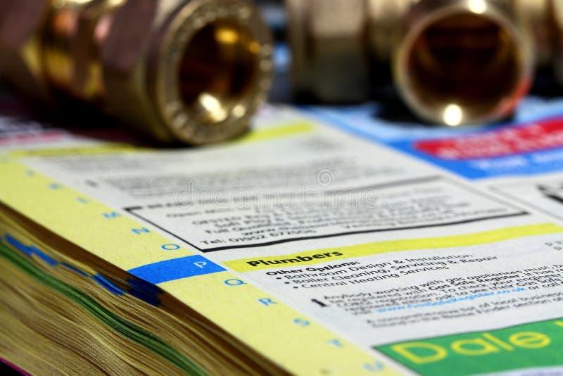 De gele folder A van de pagina'stelefoon stock foto