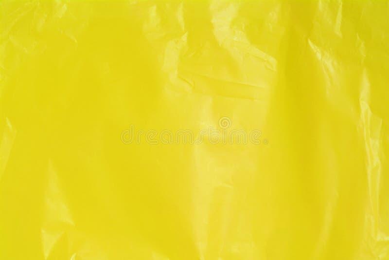 De gele gerimpelde achtergrond van de plastic zaktextuur royalty-vrije stock afbeeldingen