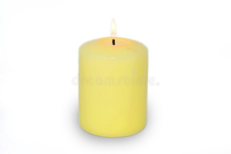 De gele kaars isoleerde wit stock foto