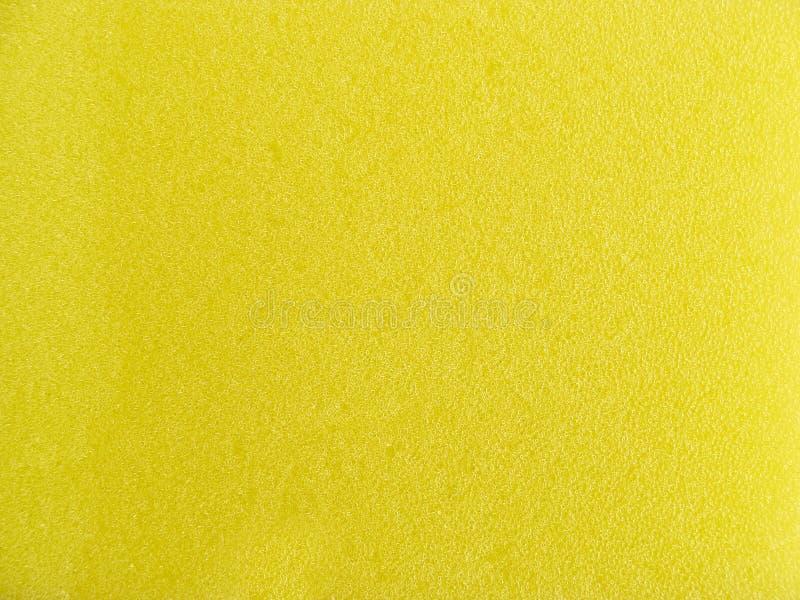 De gele textuur van de wasspons stock foto