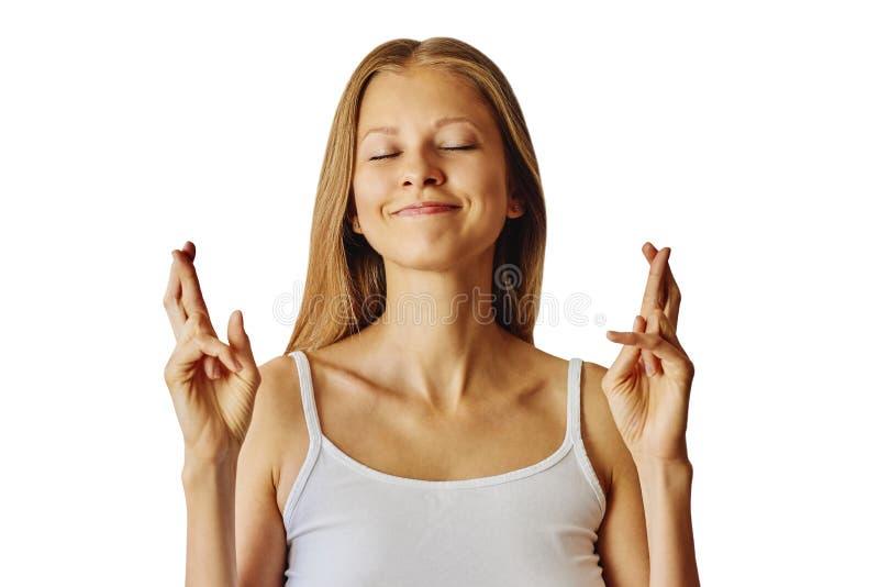 De gelukkige glimlachende vrouw houdt vingers gekruist en wenst een goed geluk dit stock foto's