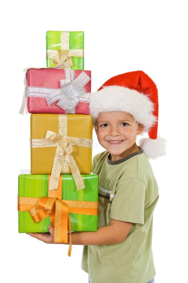 De gelukkige jongen bij Kerstmis met stelt voor stock afbeeldingen