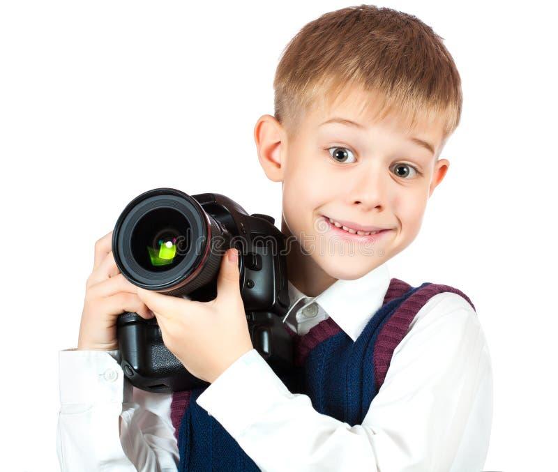 De gelukkige Jongen houdt camera en neemt een foto royalty-vrije stock fotografie
