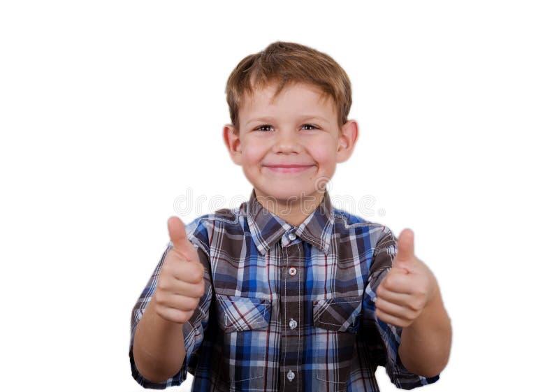 De gelukkige jongen met een glimlach en een gebaar zoals twee handen isoleren royalty-vrije stock afbeeldingen