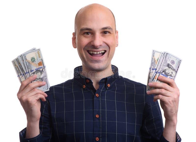 De gelukkige kale mens houdt geld royalty-vrije stock afbeeldingen