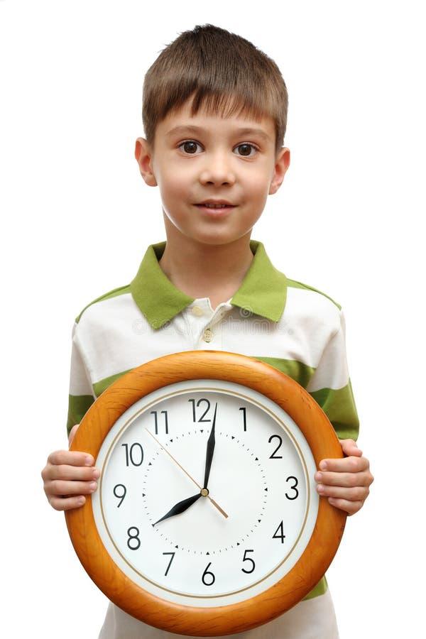 De gelukkige klok van de kindholding stock fotografie