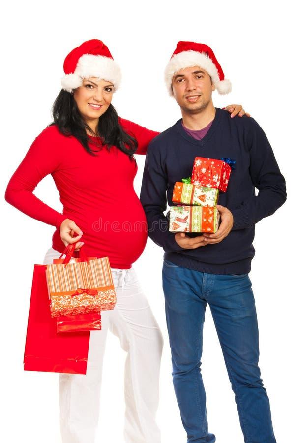 De gelukkige toekomstige ouders van Kerstmis stock fotografie