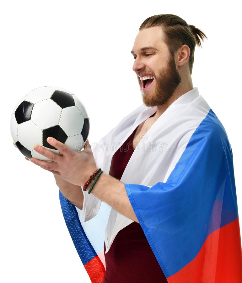 De gelukkige ventilator die van het mensenvoetbal het Russische vlag het glimlachen vieren dragen stock afbeelding
