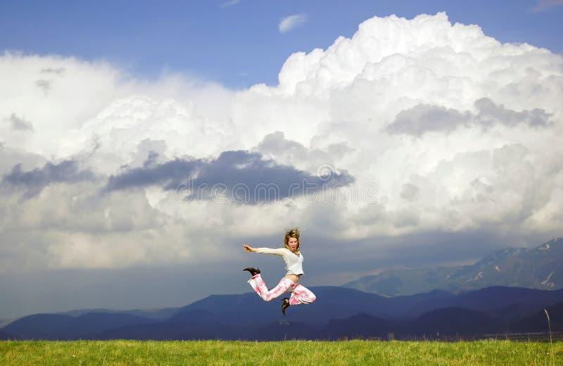 De gelukkige vrouw van de vlieg stock afbeelding