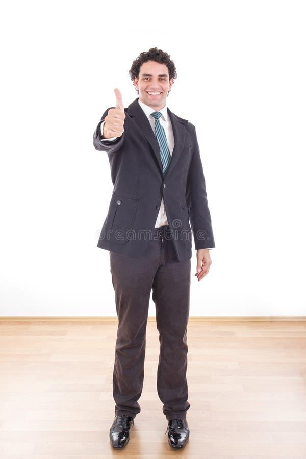 De gelukkige zakenman toont duimen stock afbeeldingen