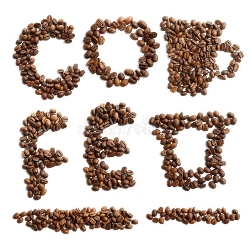 De geplaatste brieven en de symbolen van koffiebonen stock foto's
