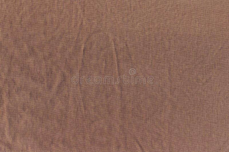 De gerimpelde textuur van bruine linnendoek royalty-vrije stock afbeeldingen