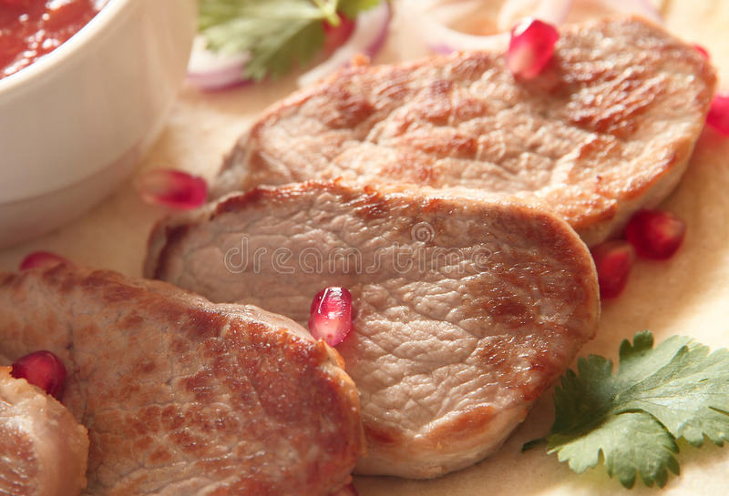 De geroosterde lapjes vlees van het varkensvleeslendestuk stock foto