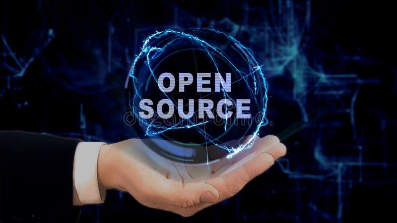 De geschilderde hand toont conceptenhologram Open bron over zijn hand stock afbeeldingen