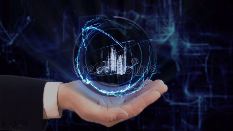 De geschilderde hand toont conceptenhologram slimme stad op zijn hand stock afbeeldingen