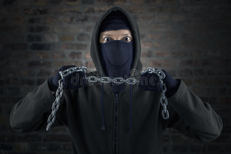 Download De Gevaarlijke Keten Van De Moordenaarsholding Stock Afbeelding - Afbeelding bestaande uit misbruik, strijd: 39115229