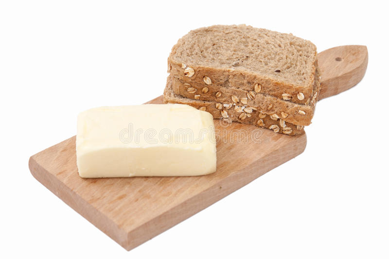 De gezonde boter van broodgraangewassen op de raad stock afbeeldingen