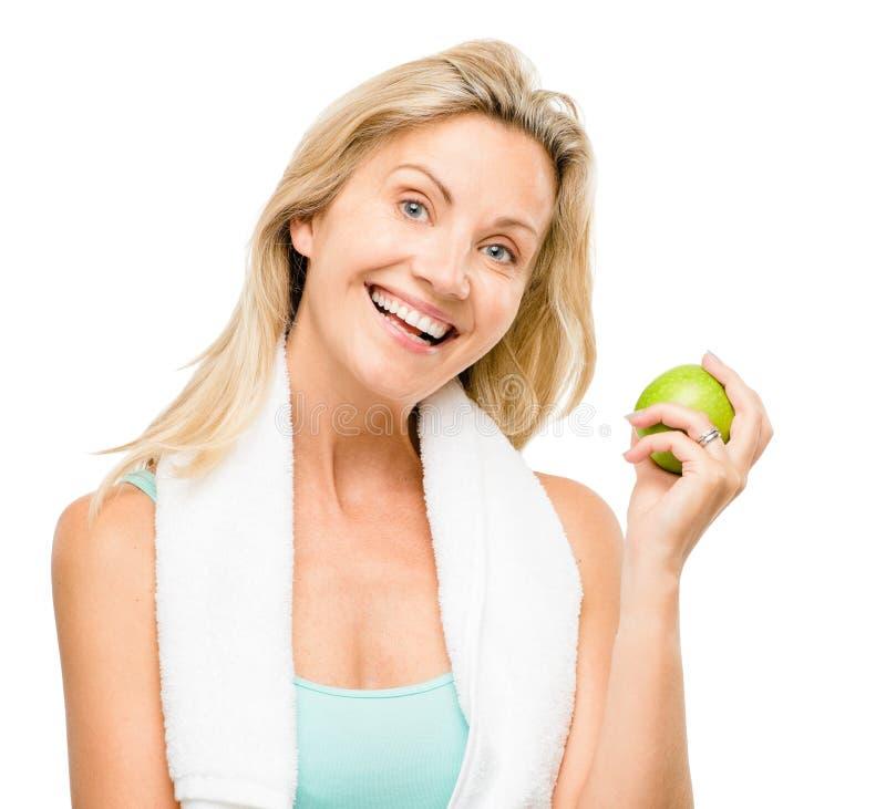 De gezonde rijpe groene die appel van de vrouwenoefening op witte rug wordt geïsoleerd royalty-vrije stock foto's