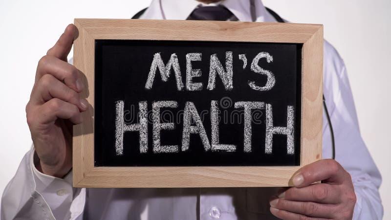 De gezondheid van mensen op bord in urologie artsenhanden wordt geschreven, reproductieve geneeskunde die royalty-vrije stock afbeeldingen